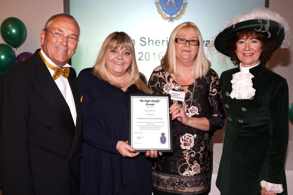 Picture Left to Right, High Sherrif of Essex, Councillor Jo McPherson, Ms Jackie Pope and one other person receiving the Queens Award for voluntary services