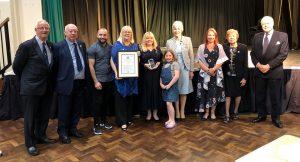 Group Photo holding award